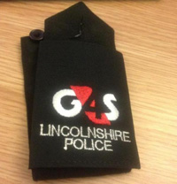 Photo of a G4S logo on a Lincolnshire Police item of security clothing